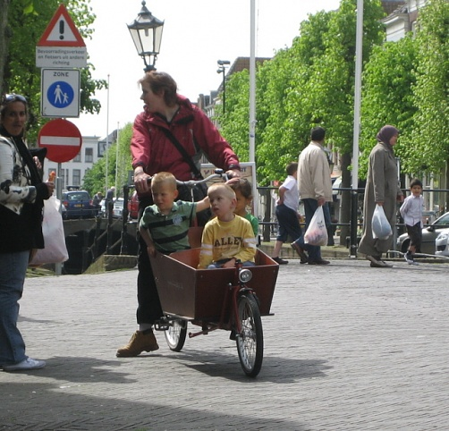Mom and her kids on a wheelbarrow bike near Gouda Holland, 4-29-09