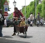 Mom and her kids on a wheelbarrow bike near Gouda Holland, 4-29-09