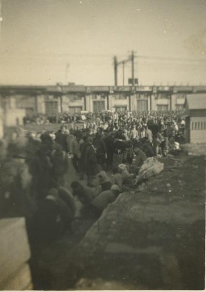 Sidewalk vendors next to RR station.