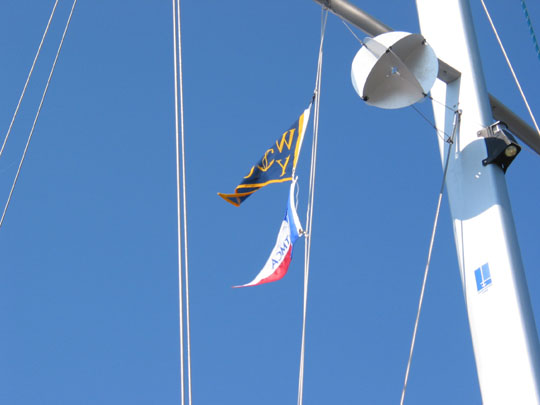 TMCA burgee flying from our flag halyard after landfall in Mobile. The round thingy is our radar reflector.