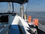 Sailing in the open Gulf. The orange jerry cans are extra diesel.