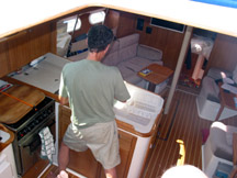 Moi, doing dishes at 12 degrees while crossing the Gulf.