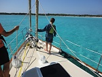 Teaching my son how to drop the anchor off Great Exuma island.