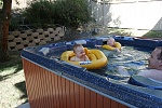 Backyard Jacuzzi is an olympic pool to the kids