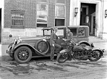 Traffic officer with Auto Stutz Police Cycle in front of headquarters building 1928.