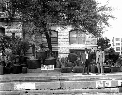 Confiscated stills in front of the courthouse - Circa 1920