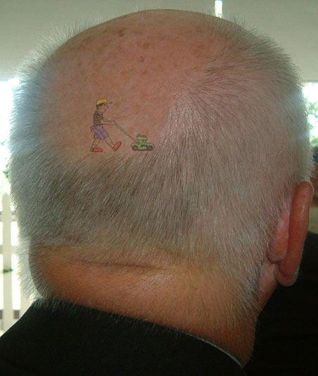 bald guy tattoo